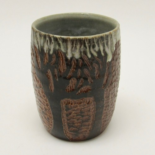 Wendy Jackson hand carves pottery. This is a tree design on a handleless cup. Find this and other work in the gallery or online. League of NH Craftsmen, wedding gifts, home decor