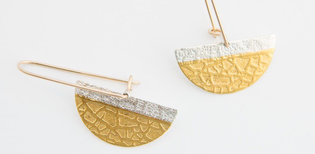 Earrings made by Beth Simon with a combination of 24k gold kuemboo and fine silver. Textured 1/2 moon earrings elegant but can be worn everyday. Find Beth's work at the Littleton League gallery and gift shop at 81 MAin Ít Littleotn , NH in the heart of the White Mountains.