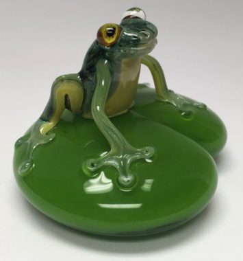 Glass frog on a lily pad by artist Chris Sherwin. Find other birds and vases handblown by Chris at the Littleton League Gallery located on Main St and along the Amonoosuc River downtown Littleton NH