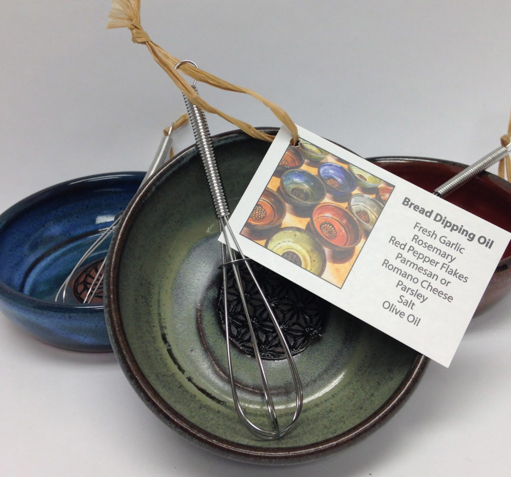 If you are entertaining or looking for the perfect hostess gift these ceramic garlic grater and dip dishes that come with a recipe are the answer. Found online or at 81 Main St Littleton NH at the Littleton League Gallery.