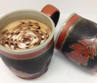 Lloyd Hamovit mugs with oak leaves available at the Littleton League of NH Craftsmen gift store