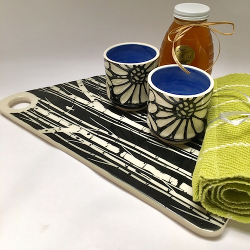 platter by Melynn Allen with birch trees and wine, tea or water cups with floral design . Handwoven kitchen towel by Kate Kilgus. Gifts Handmade Littleton NH