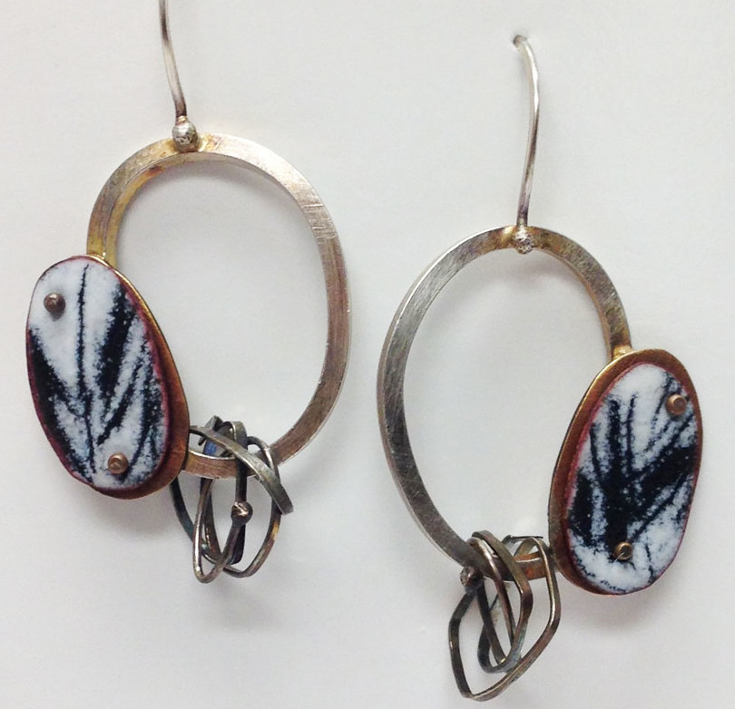 Lauren Pollaro is a metalsmith working with enamel and mixed metal incorporated in her jewelry. Find her work in Littleton, NH at the League of NH Craftsmen Gallery on Main St